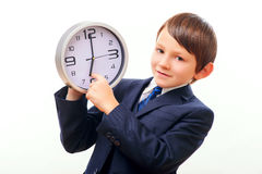 Business child in suit and tie posing with clock Stock Photo