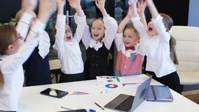 Business children in office making pile of hands stock video footage