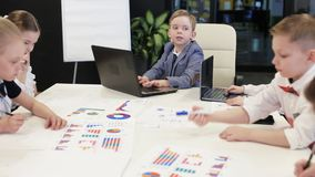 Business Children In Suits Are Sitting At The Table In The Office stock footage