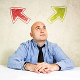 Business choice or making decision. Businessman looking at arrow above him. Concept of choice, choosing between possible solutions Royalty Free Stock Images