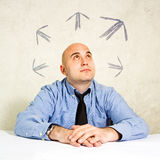 Business choice or making decisions. Business choice or business making decisions. Businessman looking at arrows above him. Concept of choice, choosing between Stock Images