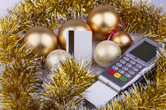 Business Christmas of payment terminal, credit. Business Christmas - payment terminal, credit Cards, balls, tinsel Stock Images