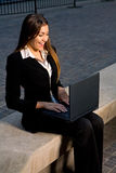 Business in the City. Happy Businesswoman Having a Fun, Private Moment on Her on Laptop in the City Stock Photos