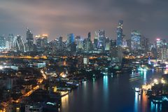 Business city Bangkok Transportation at Dusk with Modern Busines. S Building along the river Thailand Royalty Free Stock Image