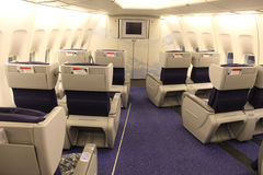 Business class cabin. Insde a modern airliner royalty free stock photography