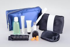 Business class essential travel kit. Amenity kits on long-haul international flights. Business Class Essential travel kit royalty free stock images
