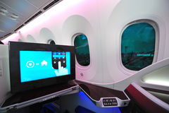 Business class seat and inflight entertainment system onboard Qatar Airways Boeing 787-8 Dreamliner at Singapore Airshow. SINGAPORE - FEBRUARY 12: Business class stock images