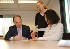 Business client signs contract Royalty Free Stock Photography