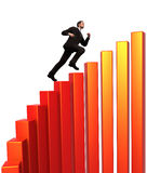 Business Climber. Business man running and climbing the steps of rising finance graph Royalty Free Stock Photography
