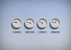Business clocks on blue wall royalty free stock images