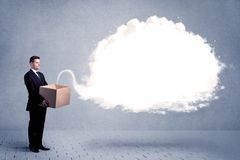 Business cloud in box. A young cheerful business person holding a cardboard box with illustration of white empty cloud concept royalty free stock photo
