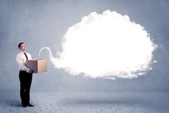 Business cloud in box. A young cheerful business person holding a cardboard box with illustration of white empty cloud concept royalty free stock image