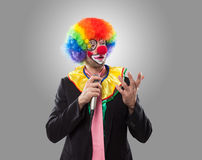Business clown talking with a microphone Stock Images