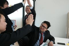Business co-worker team raise hands with happiness for successful project. cheerful businessman showing gladness for achievement. Business co-worker team raise royalty free stock photo