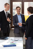 Business co-workers shaking hands. Portrait of business co-workers shaking hands royalty free stock images