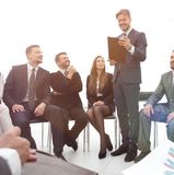 Business coach communicate with the business team. The concept of team building Royalty Free Stock Photo