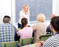 Business coach in front of students Stock Image