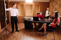 Business coach holding training for his staff. royalty free stock photos