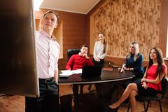 Business coach holding training for staff, people in office holding a conference and discussing strategies. Business coach holding training for staff stock image