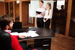Business coach holding training for staff, people in office holding a conference and discussing strategies. Business coach holding training for staff stock photo