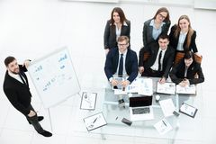 Business coach teaching employees on whiteboard at corporate training.  stock images