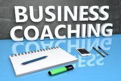 Business Coaching text concept. Business Coaching - text concept with chalkboard, notebook, pens and mobile phone. 3D render illustration Royalty Free Stock Image