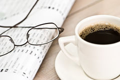 Business Coffee Break. Coffee break with newspaper and stockmarket figures stock photography
