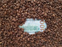 Business coffee, reverse side of 100 dollar bill with coffee beans background. Price and value of coffee, loads of coffee beans toasted, ingredient for drinks royalty free stock photography