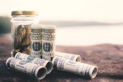 Business and coins in a glass jar royalty free stock images