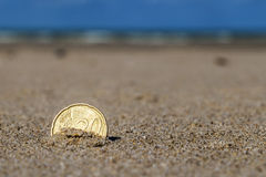 Business coins at holiday in the sand on the beach, North Sea Royalty Free Stock Photos
