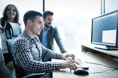Business collaboration in office by colleagues Stock Image