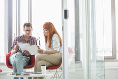 Business colleagues analyzing documents in creative office Royalty Free Stock Images
