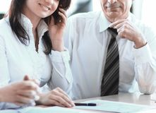 Business colleagues analyzing financial statistics sitting at a Desk royalty free stock photography