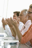 Business Colleagues Applauding In Meeting Room Stock Images