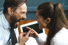 Business colleagues argue and yell at each other stock photos
