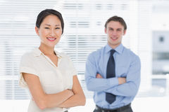 Business colleagues with arms crossed in office Stock Photos