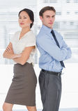 Business colleagues with arms crossed in office Royalty Free Stock Photo