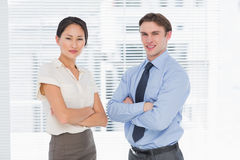 Business colleagues with arms crossed in office Stock Photo