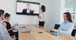 Business colleagues attending a video call in conference room 4k