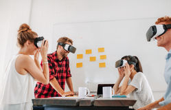 Business colleagues brainstorming using VR goggles Stock Photo