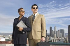 Business Colleagues On Building Rooftop Stock Photo