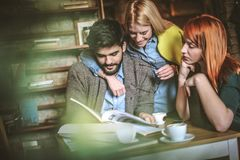 Business colleagues at cafe researching together. Lifestyle Stock Image