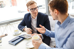 Business Colleagues Chatting in Cafe royalty free stock image