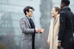 Business Colleagues Chatting in Snowy Street royalty free stock images