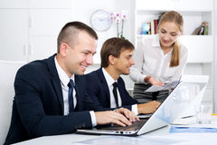 Business colleagues chatting about work task Royalty Free Stock Image