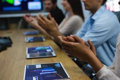 Business colleagues clapping hands in meeting Stock Images