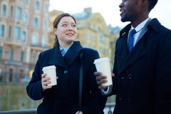 Business Colleagues with Coffee in Street stock images