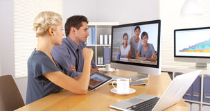 Business colleagues collaborating with team overseas. In the office stock photo