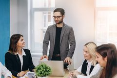 Business colleagues in conference meeting room during presentation royalty free stock photography