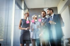 Business colleagues working in modern conference room. Business colleagues in conference meeting room during presentation stock photos